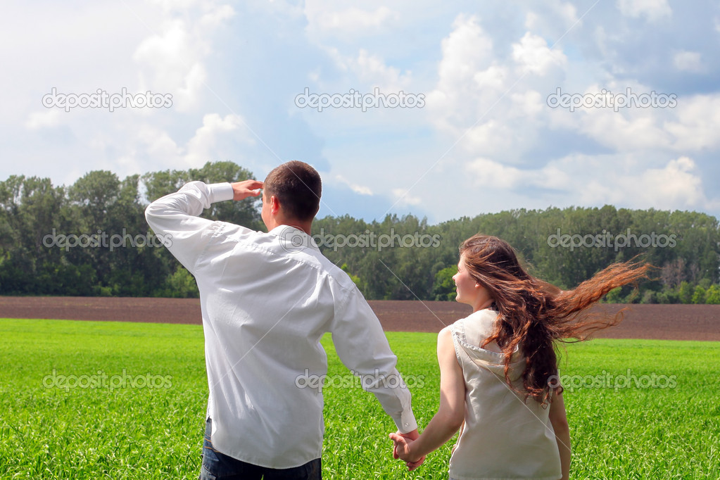 Happy young man and teenage girl in the summer field — Stock Photo #8968338
