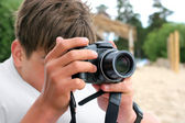 Teenager with camera — Stock Photo