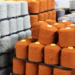 Many bobbins of yarn - Stockfoto
