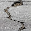 Crack in the street — Stock Photo