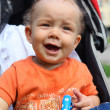 Little happy boy with baby carriage in — Lizenzfreies Foto