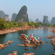 Local boatmen gather at Lijiang River banks - Stock Photo