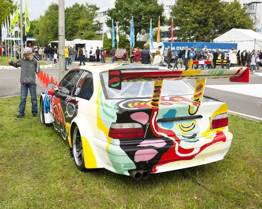 An artistically painted BMW M3 GTR on display at the annual National Oldtimer Day on June 19, 2011 in Lelystad, The Netherlands — Lizenzfreies Foto #8458165