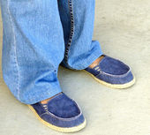 Denim pants and shoes. — Stock Photo