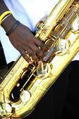 Baritone saxophone player. — Stock Photo