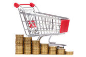 Shopping cart and coins — Stock Photo
