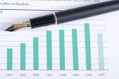 The chart business of growth and a pen — Stock Photo