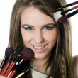 The beautiful girl with brushes for a make-up - Stock Photo