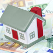 Toy house for euro banknotes as a background — Stock Photo #10715141