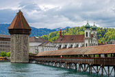 Panoramic view of Chapel Bridge, famous covered wooden bridge. Lucerne Switzerland — Stock Photo