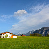 Alpine landscape in Austria: mountains, forests, meadows and a farm — Stock Photo