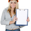 Beautiful girl in a building helmet With clipboard — Stock Photo #8056004