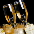 Champagne with Christmas ornaments - Stock Photo