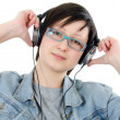 Stock Photo: Girl listens to music through ear-phones