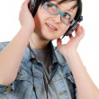 Girl listens to music through ear-phones — Stock Photo #8163595