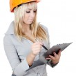 Beautiful girl in a building helmet With clipboard — Stock Photo #8163649