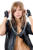 The beautiful girl in a leather jacket with a chain — Stock Photo