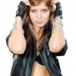 The beautiful girl in a leather jacket with a chain — Stockfoto #8257658
