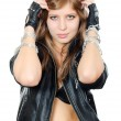 The beautiful girl in a leather jacket with a chain — Stockfoto