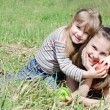 Two girls with apples — Stock Photo #8459286