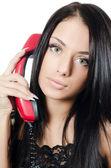 La hermosa chica con teléfono rojo — Foto de Stock