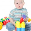 The little boy plays multi-coloured toys — Stock Photo #8683080