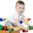 The little boy plays multi-coloured toys — Stock Photo #8683088