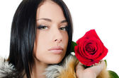The girl with beautiful hair with a red rose — Stock Photo