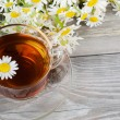 Stock Photo: Glass cup with camomile tea