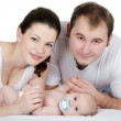 Portrait of a young happy family with the kid — Stock Photo