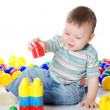 The little boy plays multi-coloured toys — Stock Photo #8767562