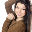 The beautiful girl in a brown sweater isolated — Stock Photo
