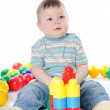 The little boy plays multi-coloured toys — Stock Photo #8854702