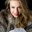 The beautiful girl with playing card — Stock Photo #8897538
