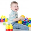 The little boy plays multi-coloured toys — Stock Photo #8897721