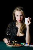 The beautiful girl with playing card — Stock Photo