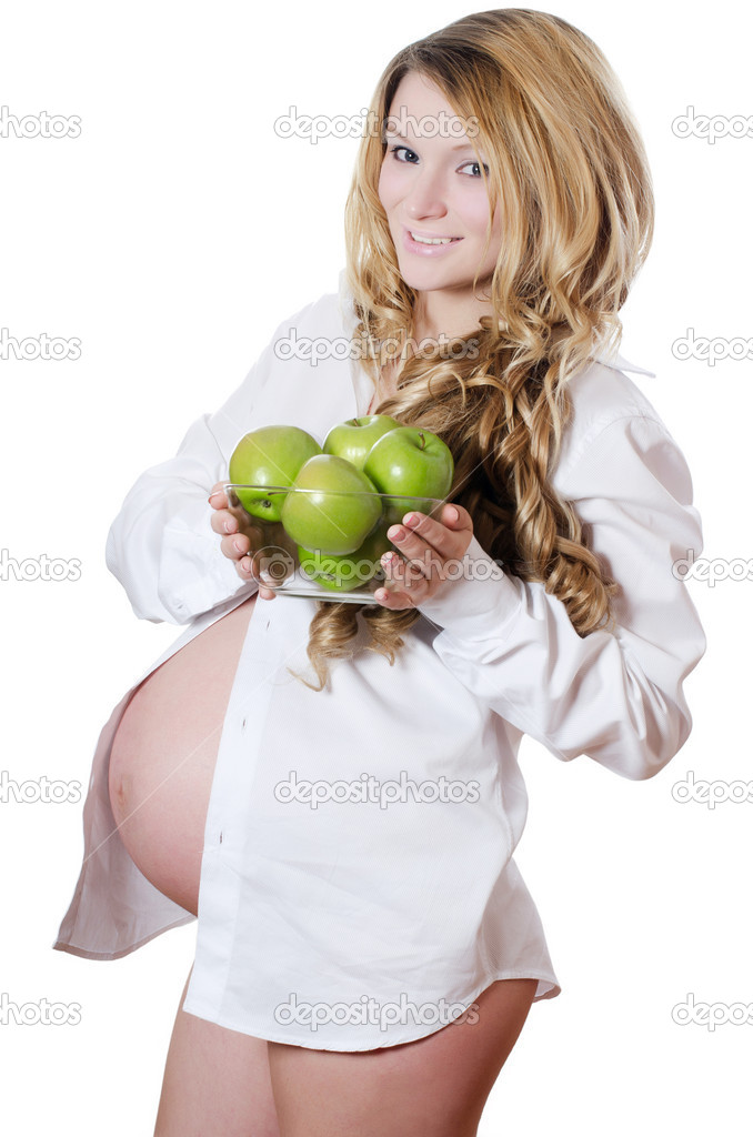 Pregnant woman with apples isolated on white — Stock Photo #8897571