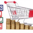 Royalty-Free Stock Photo: Coins in the form of the diagramme, shopping cart and word SALE