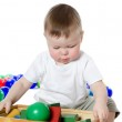 The little boy plays multi-coloured toys — Stock Photo #9019024