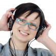 Girl listens to music through ear-phones — Stock Photo #9149405