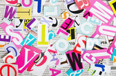 The letters which have been cut out from newspapers close up — Stock Photo