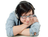 Girl listens to music through ear-phones — Stock Photo
