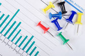 Graphs, charts with multi-coloured push buttons — Stock Photo