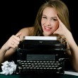 The beautiful girl at a typewriter. A retro style — Stok fotoğraf