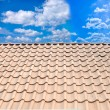 Roof from a tile against the blue sky - Stock Photo