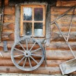 Facade of ancient wooden log hut — Stock Photo