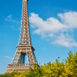 Eiffel Tower in the blue sky - Stock Photo
