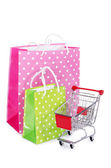 The shopping cart and bags isolated on white — Stock Photo