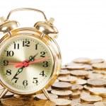 Alarm clock and money isolated on white background — Stock Photo #9641753
