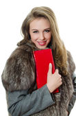The beautiful girl with red handbag — Stock Photo